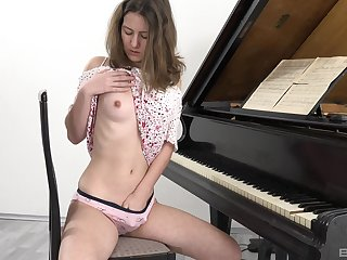 Playing the piano is boring, so Gina Austin decides to goat her pussy