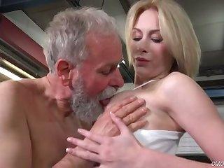 Bearded grey man sucks juicy tits of fresh looking charming gal